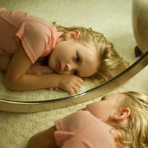 little girl in mirror