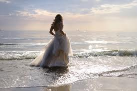 bride walking in the waves