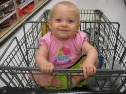 happy baby in grocery cart