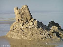 sand castles washed away