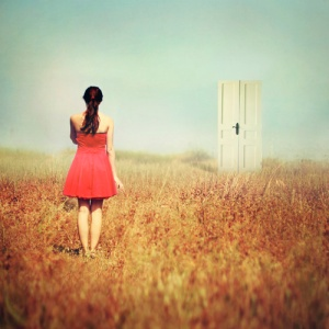 girl at a new door out in field