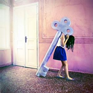 girl carrying huge key